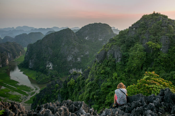 On the top of the mountain and you can see the wonderful beauty of Tam Coc